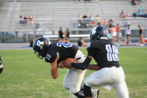 Dominic Gonnella (25), just a freshman, had a pretty good game on the ground for the Sharks.