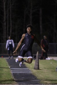 Hillsborough's Duran Bell triple jumps at the New Tampa Preseason Track and Field Classic at Wharton High School in February.