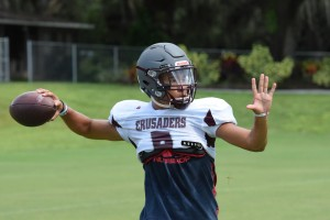 Seffner Christian Academy So. QB Isaiah Knowles warming up during practice.